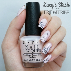 Bow nail art with OPI Don't Burst My Bubble LRG 1