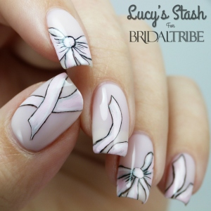 Bow nail art with OPI Don't Burst My Bubble LRG 6